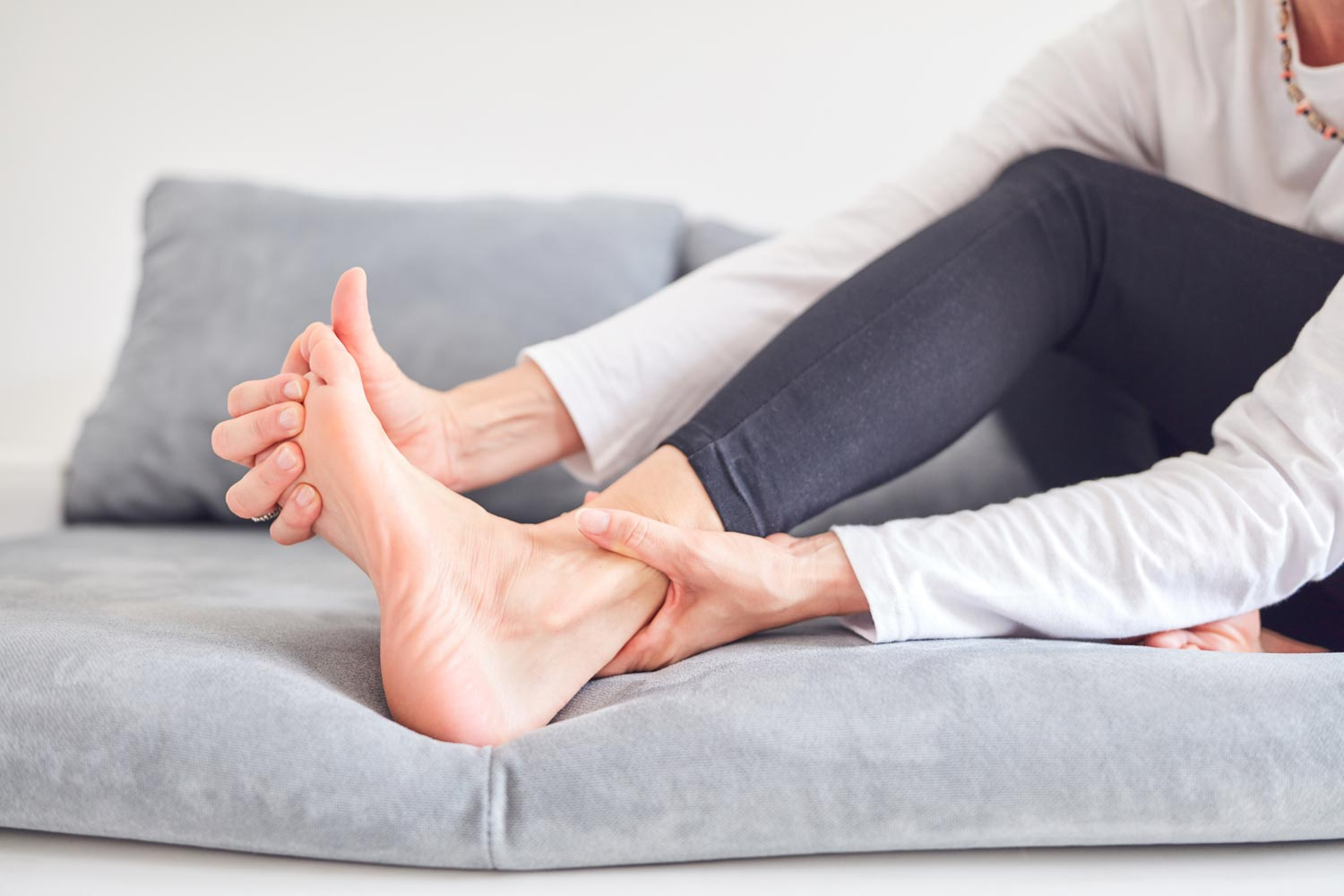 Holding heel and stretching toes